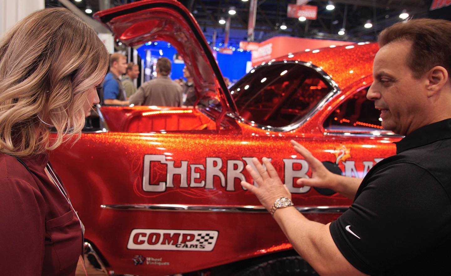 Members of the Tint World team check out automotive industry innovations at SEMA